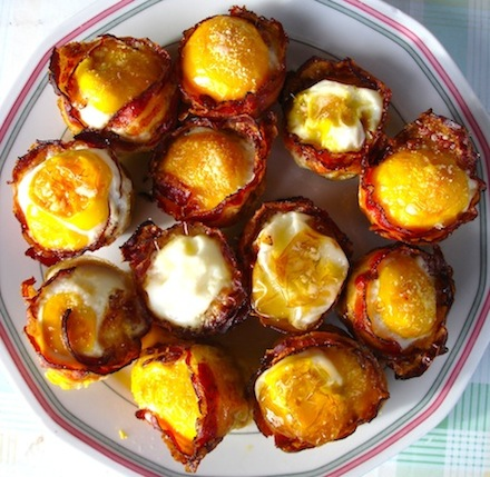 plate full of bacon and egg cups